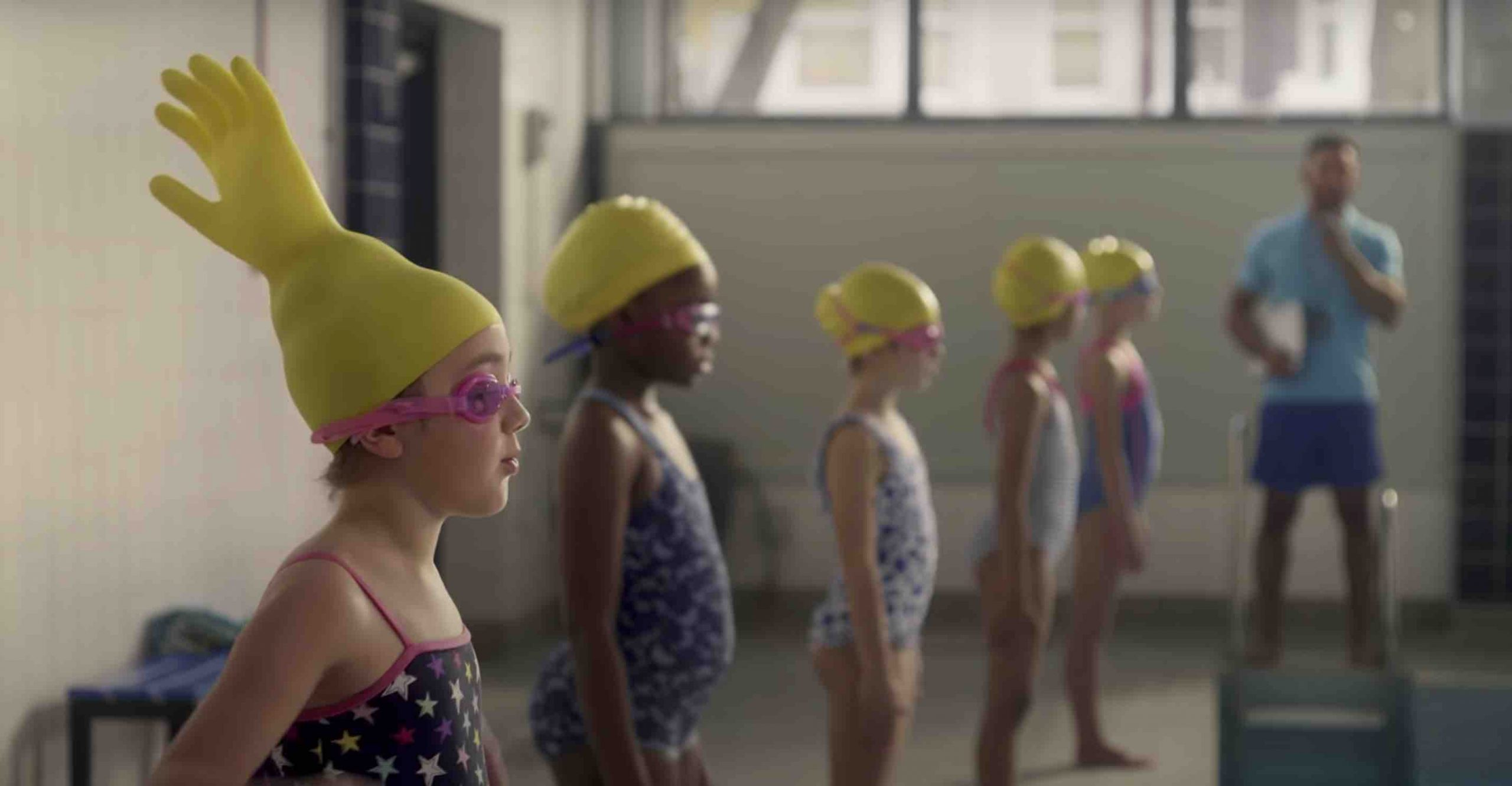 Swimming girl with rubber glove on her head from a funny McDonald's advert